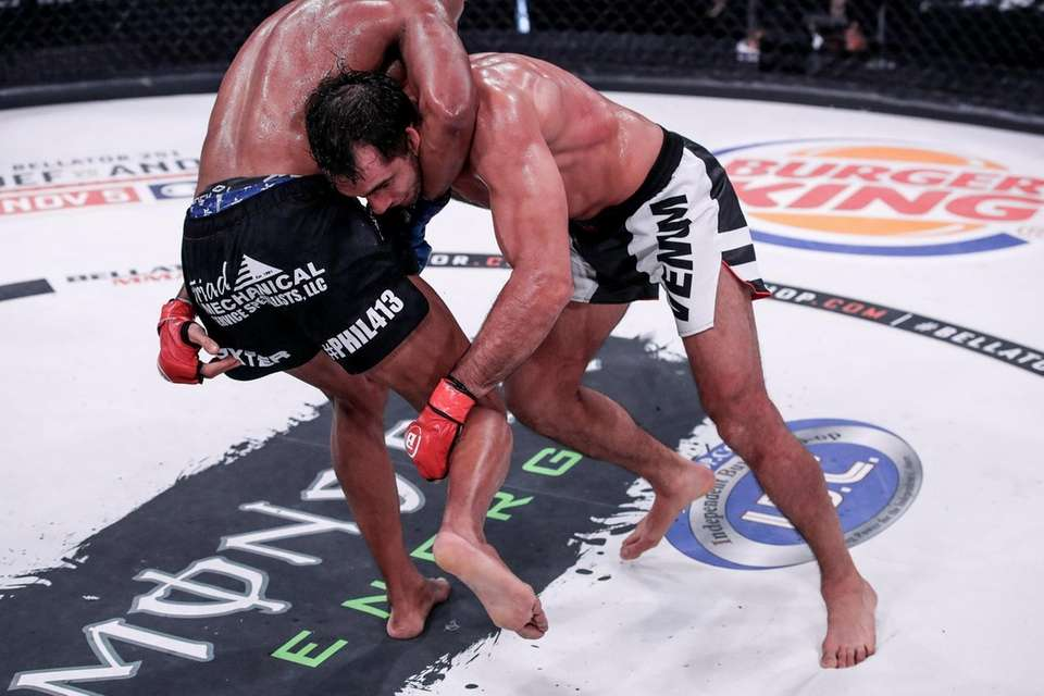 Gegard Mousasi, in the red gloves, and Douglas
