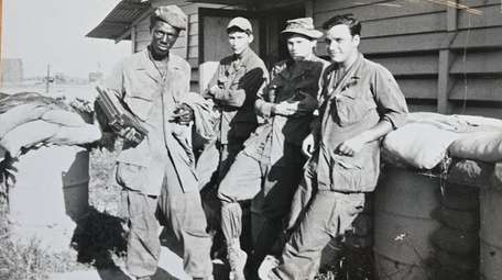 Photo of Tony Jimenez, right, while serving in