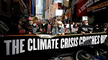 Demonstrators representing climate and racial issues march on