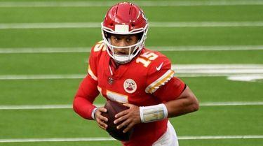 Kansas City quarterback Patrick Mahomes scrambles against the