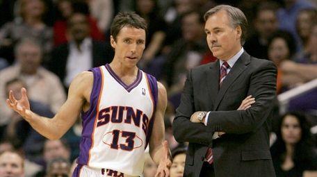 Suns guard Steve Nash, left, talks with head