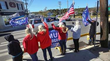 Supporters of Donald Trump line Main Street in