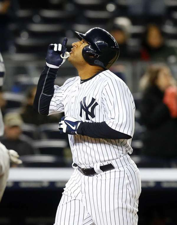 Vernon Wells of the Yankees celebrates his eighth-inning,