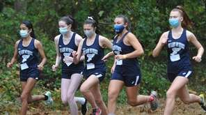 Our Lady of Mercy Academy runners begin the