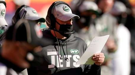 Jets head coach Adam Gase watches play against