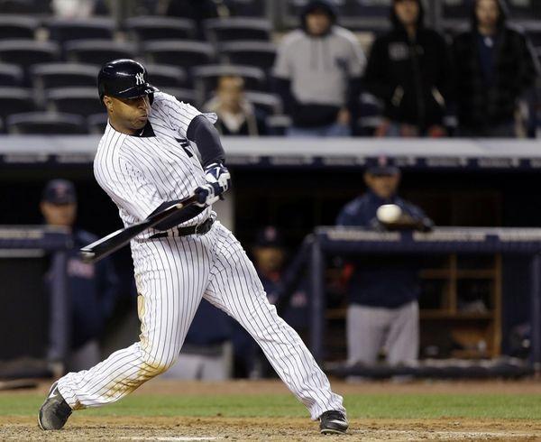 Vernon Wells hits an eighth-inning, three-run homer, his