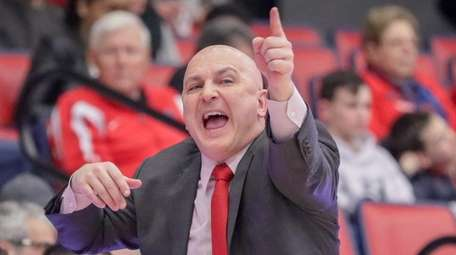 Stony Brook head coach Geno Ford reacts to