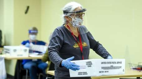 Election judges wearing masks and face shields in