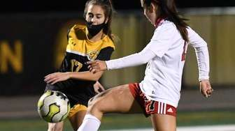 St. Anthony's Olivia Perez kicks the ball past