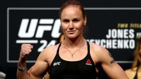 Valentina Shevchenko poses on the scale during the