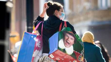 A woman wears a mask while shopping Wednesday