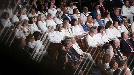 A group of Democratic Congresswomen wearing white to