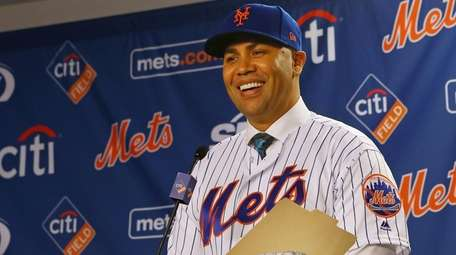 Carlos Beltran talks after being introduced as manager