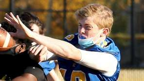 Kellenberg DB Thomas Sluka breaks up the St.