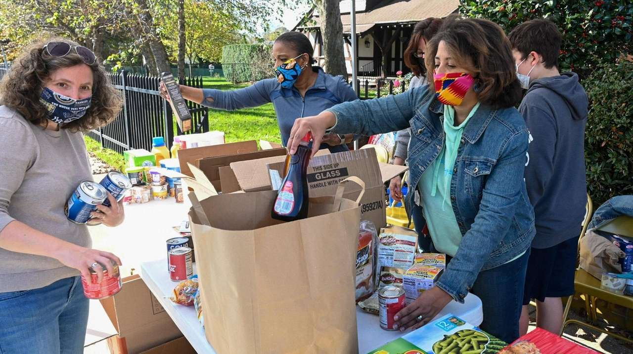 Volunteers sorted through donated food in front of