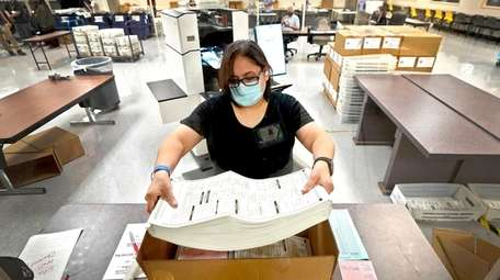 Arizona elections officials continue to count ballots inside