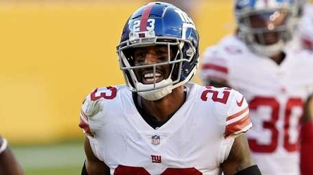Logan Ryan of the Giants reacts after making