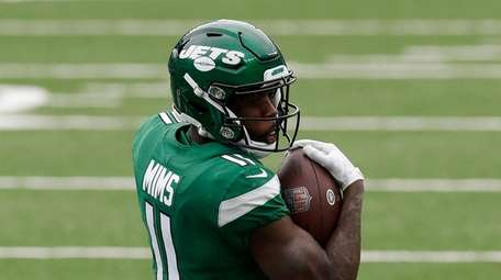 Denzel Mims #11 of the Jets runs the