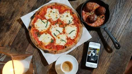 A margarita pizza and a trio of arancini