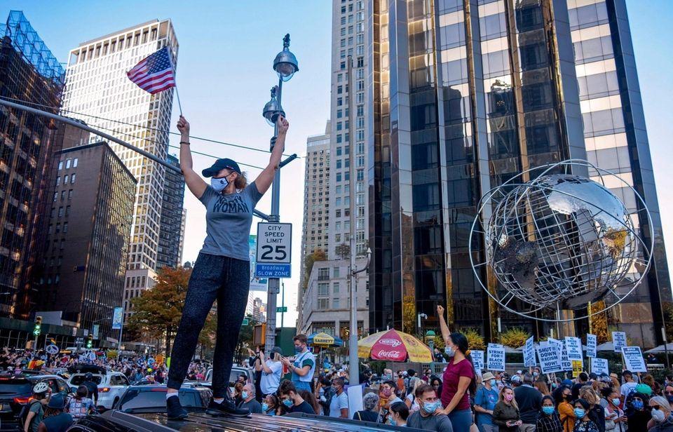 People celebrate in New YorkÕs Columbus Circle Saturday,