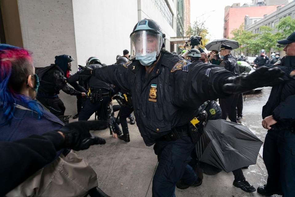 Members of the NYPD arrest people opposed to