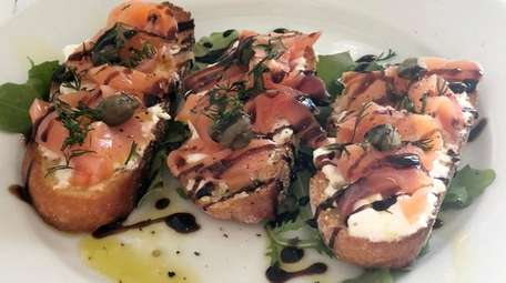 Smoked salmon crostini with burrata at Angelo's, which