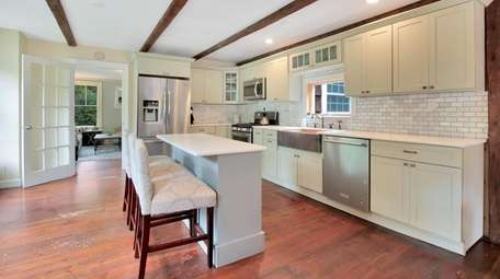 The updated kitchen has granite counters, custom cabinets