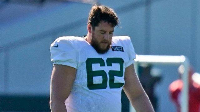 The  Jets' Greg Van Roten, left, George