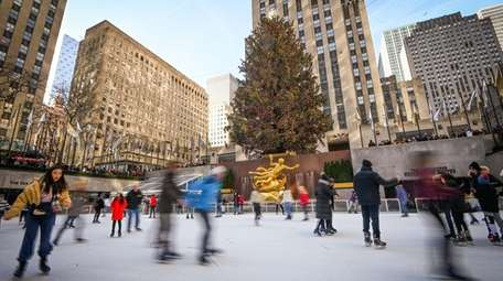 Visitors coming to Rockefeller Center this holiday season