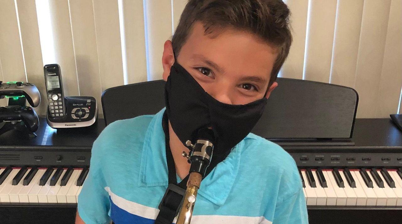 Justin DeRosalia, 12 of Selden, playing the alto