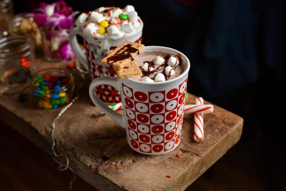 Spiked hot chocolate topped with marshmallows, graham crackers,