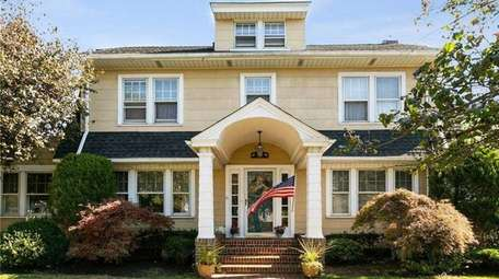 This classic Dutch Center Hall Colonial and comes
