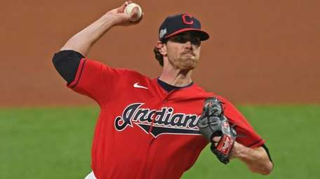 Cleveland starting pitcher Shane Bieber delivers in the