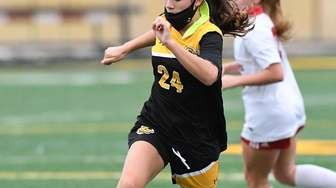 St. Anthony's Emily Riggins controls the ball against