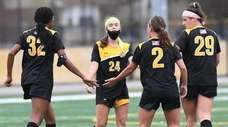 St. Anthony's forward Felicity Permenter-Davis, left, celebrates a