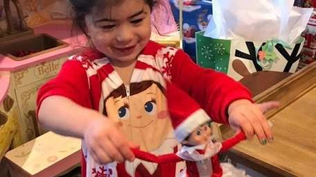 Tianna Ferreira, 5, of Wantagh, holds her Elf