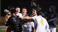 St. Anthony's players mob goalkeeper Christian Micheli after