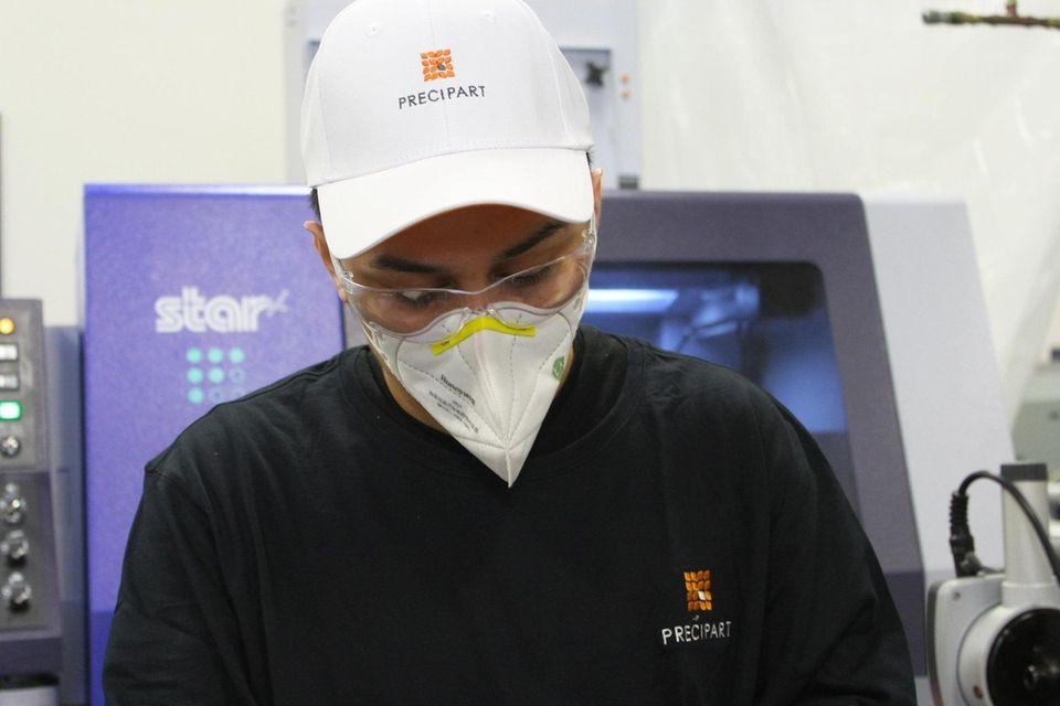 Jonathan Villatoro, a machine operator in the small