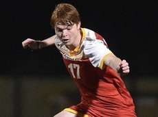Jack Doherty #17 of Chaminade, left, moves the