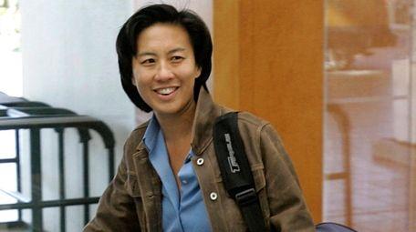 Kim Ng walks through the hotel lobby during