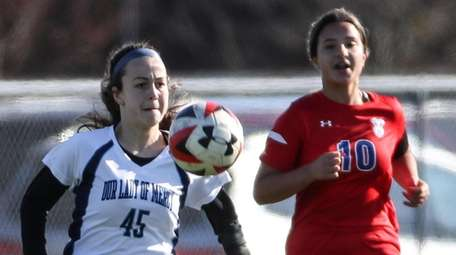 Brooke Vetter of Our Lady of Mercy keeps
