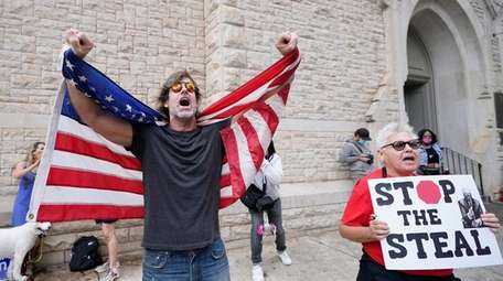 Supporters of President Donald Trump protest near the