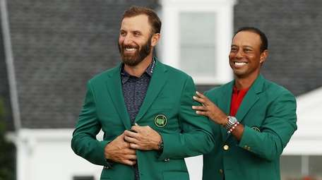 Dustin Johnson of the United States is awarded