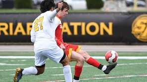 Chaminade midfielder Liam Russelman kicks the ball away