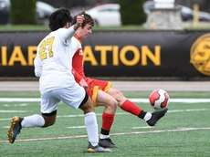 Chaminade midfielder Liam Russelman kicks the ball away