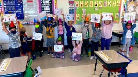 In Long Beach, West Elementary School students hold