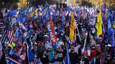 Thousands of supporters of President Trump march along