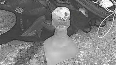 The bottle of Patrón tequila — part of