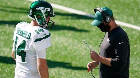 New York Jets head coach Adam Gase, right,