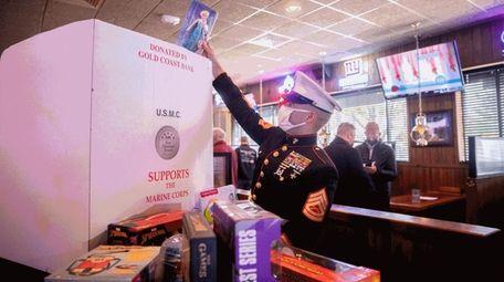 Marine John Sardine placed toys in the donation